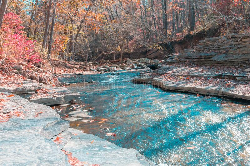 Rocky blue water falls flowing down tanyard creek. In the fall, fall colors, trees,red, yellow, green,brown stock image