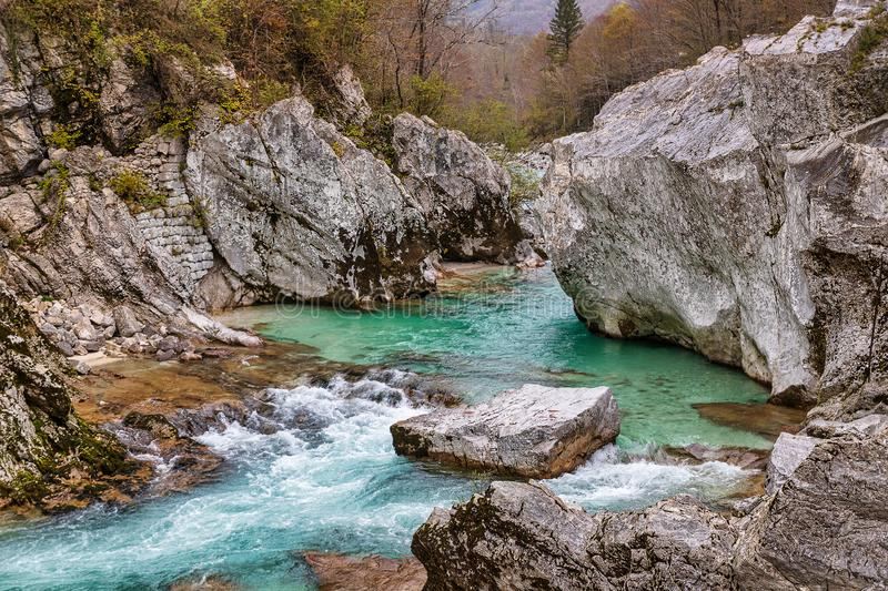 Rocky canyon and clear emerald waters of Soca river, Slovenia royalty free stock images