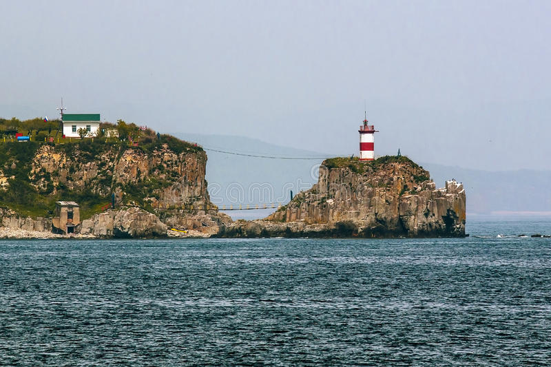 Rocky Cape with a lighthouse royalty free stock images