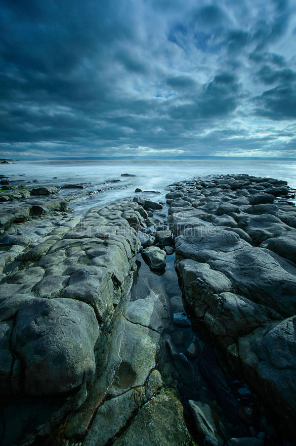 Rocky Channel at Nash Point. A channel in between the rocks leading to the sea at Nash Point, on the Glamorgan Coast, Wales stock photography