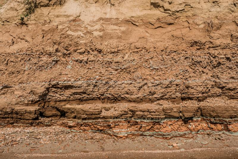 Rocky clay texture on a cliff stock images
