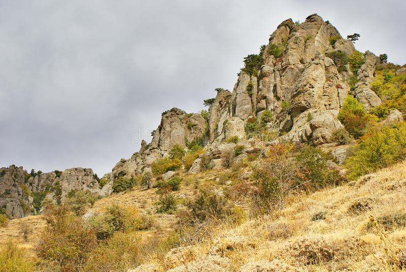 Rocky cliff with a bizarre rocks royalty free stock photos