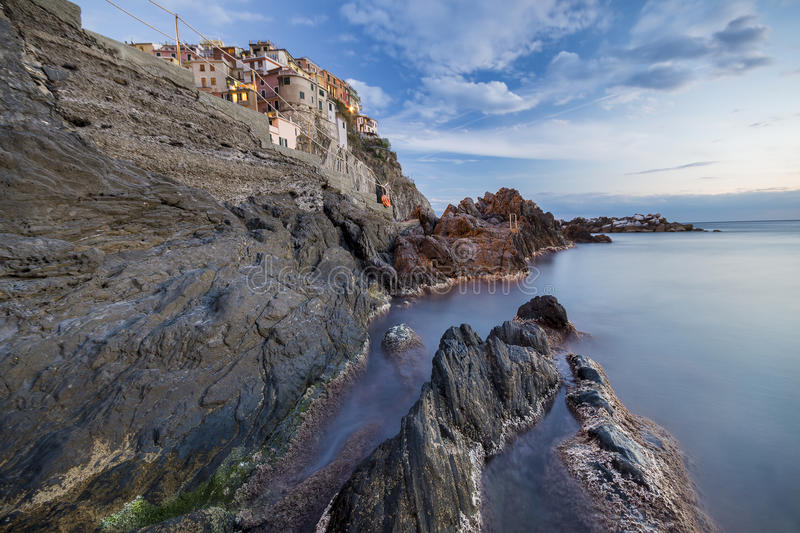 Rocky cliff in Manarola at night stock image