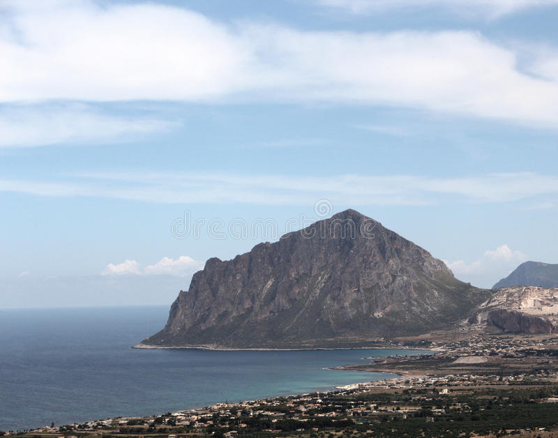 Rocky cliffs of monte cofano, trapani. An overall view of monte cofano, custonaci, near san vito lo capo, trapani, landscape cut stock photo