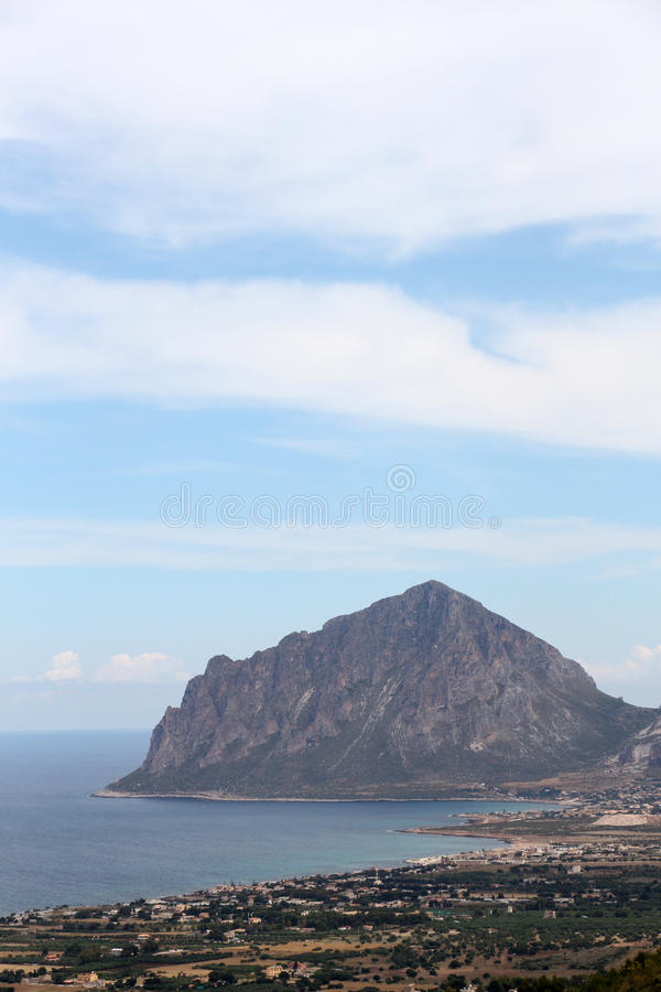 Rocky cliffs of monte cofano, trapani. An overall view of monte cofano, custonaci, near san vito lo capo, trapani, portrait cut royalty free stock photography