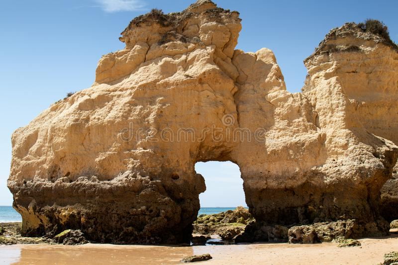 The rocky cliffs of Vale do Olival beach in Armacao de Pera. Portugal royalty free stock photo