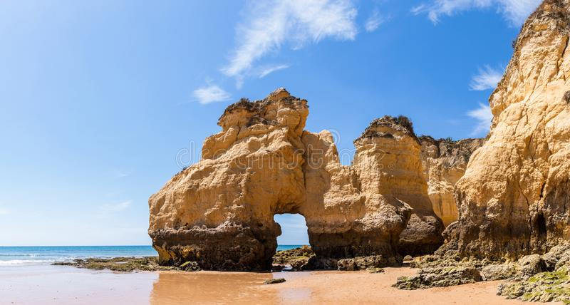 The rocky cliffs of Vale do Olival beach in Armacao de Pera. Portugal royalty free stock photography