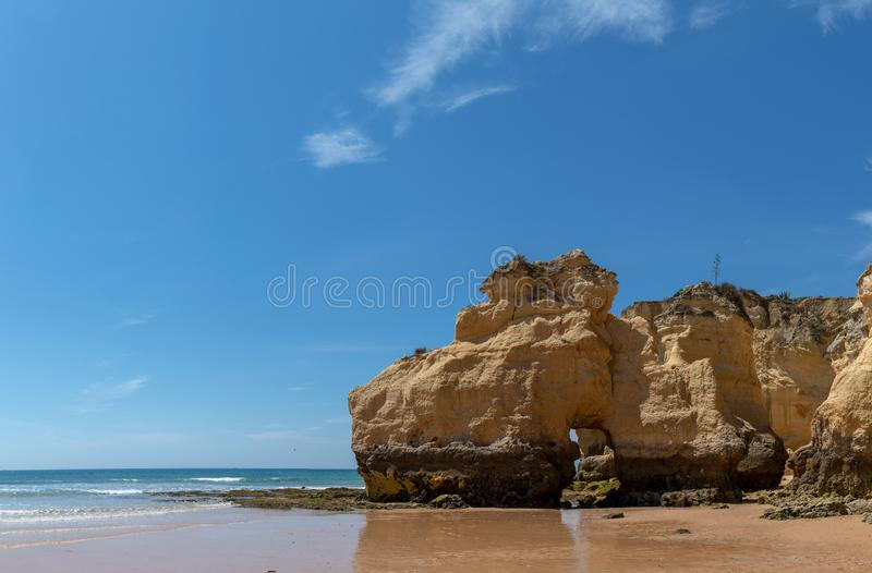 The rocky cliffs of Vale do Olival beach in Armacao de Pera. Portugal royalty free stock photos