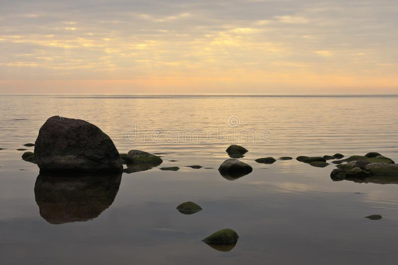 The rocky coast of the Baltic Sea at sunset. The rocky coast of the Baltic Sea in Latvia at sunset at the end of the summer royalty free stock photos