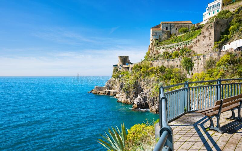 Rocky coast and clear blue sea next to beautiful Amalfi, Campania, Italy. Amalfi coast is most popular travel and holiday. Destination in Europe stock image