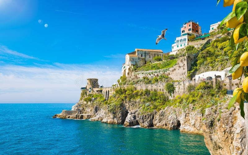 Rocky coast and clear blue sea next to beautiful Amalfi, Campania, Italy. Amalfi coast is most popular travel and holiday. Destination in Europe. Ripe yellow stock photo
