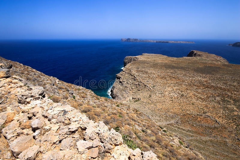 The rocky coast of Greece. Rocky coast of a greek island with beautiful blue waters and clear skies stock photos