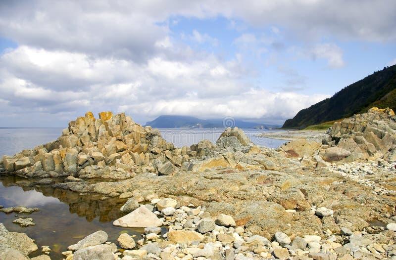 Rocky coast of island Kunashir royalty free stock images
