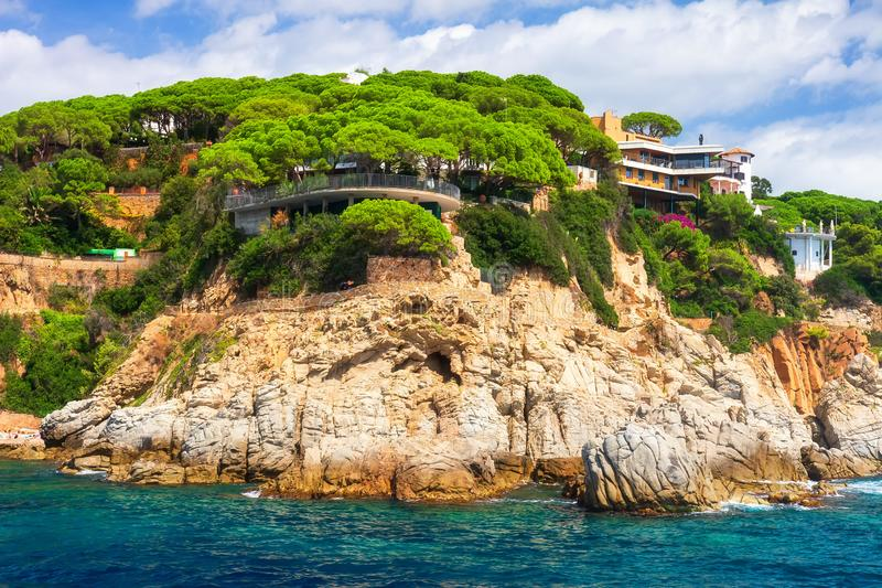 Rocky coast landscape in mediterranean with modern beautiful house on high sea shore in Costa Brava, Spain. Rocky coast landscape in mediterranean with modern stock image