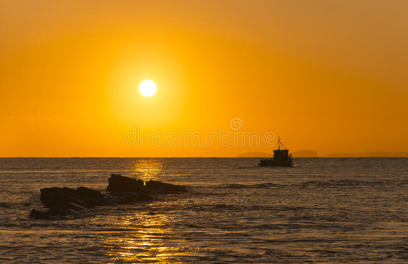 Rocky Coast Sunrise. Dawn on the Jurassic Coast in Dorset showing rocks at Peveril Point in Swanage stock photo