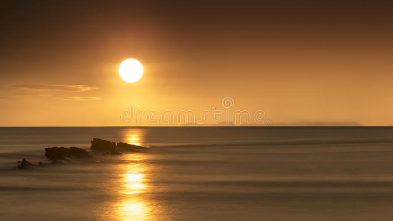 Rocky Coast Sunrise. Dawn on the Jurassic Coast in Dorset showing rocks at Peveril Point in Swanage stock image