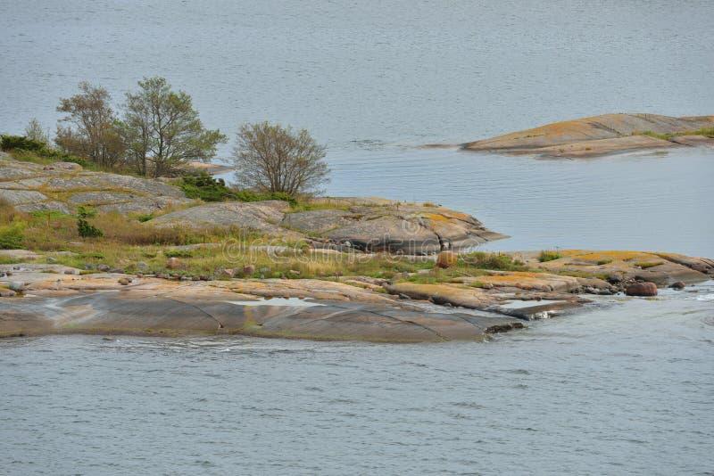 Rocky coast of uninhabited island in Baltic Sea. Aland Islands. Autumn royalty free stock photos