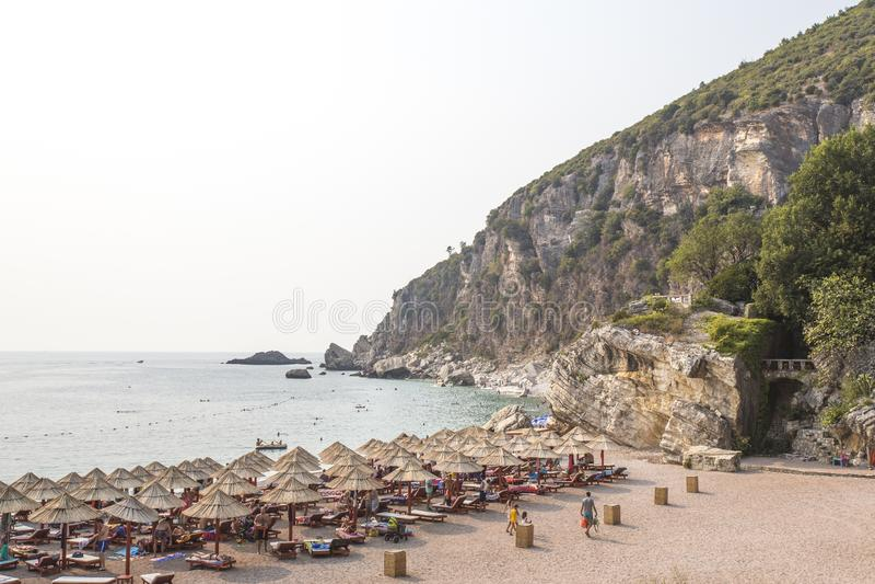 Rocky coastline, bay, beach. People are sunbathing. Europe. royalty free stock photography