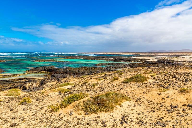 Rocky Coastline - EL Cotillo, Fuerteventura, Espanha imagens de stock royalty free