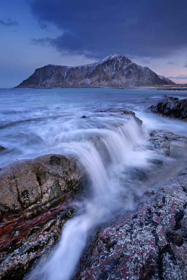Rocky coastline on the Lofoten in northern Norway at dawn stock images