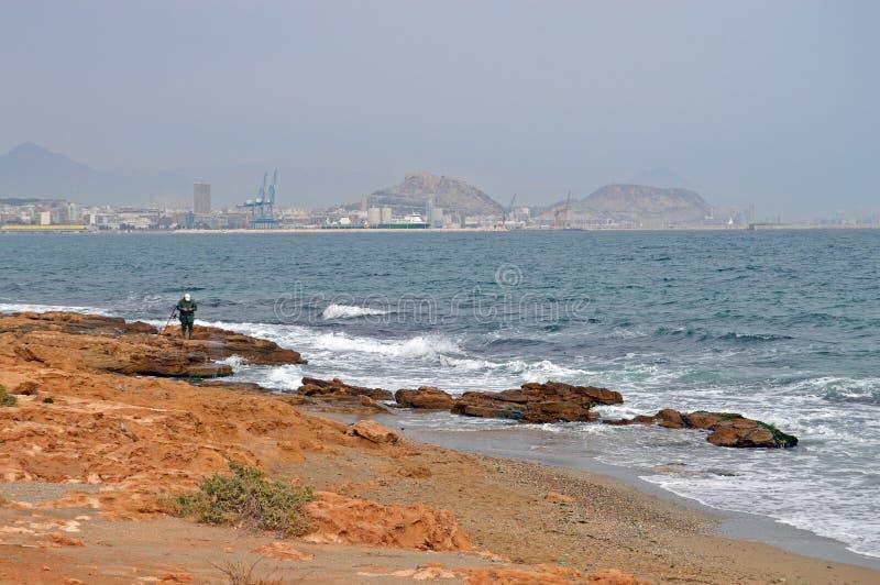 Alone On The Rocks - Alicante Sea Shore And Beach stock images