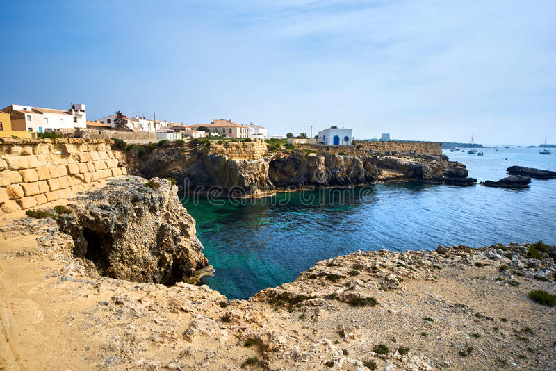Rocky coastline of Tabarca Island. Crystal-clear turquoise water. Province of Alicante. Spain stock photography