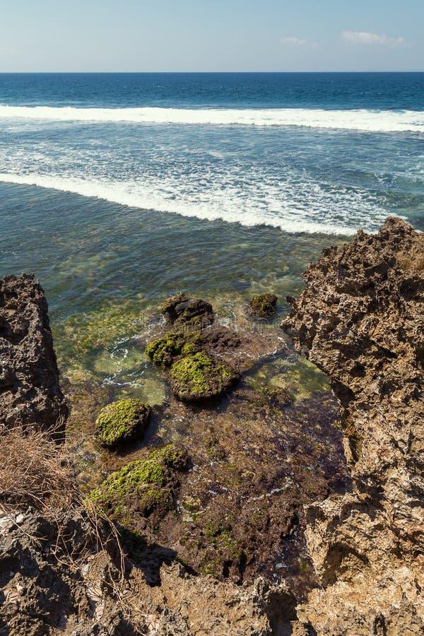 Rocky Costline and waves in Nusa Dua, Bali arkivfoto