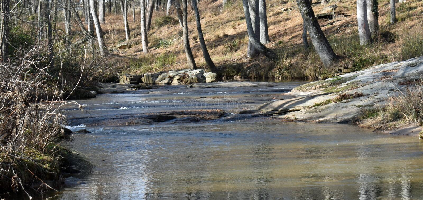 Rocky Creek Upper Shoals with trees and rocks stock photos