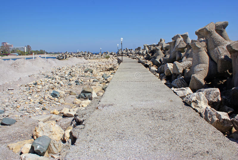 Rocky embankment near beach royalty free stock photos