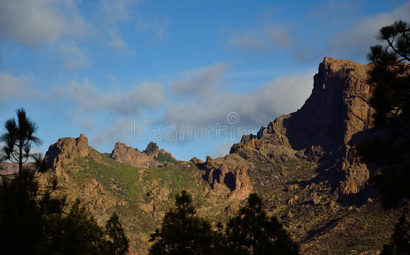 Rocky formations, La Plata, Gran Canaria. Rocky formations, blue sky and clouds, La Plata, Gran Canaria royalty free stock photos