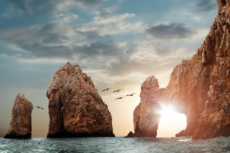 Rocky formations on a sunset background. Famous arches of Los Cabos. Mexico. Baja California Sur.  royalty free stock images