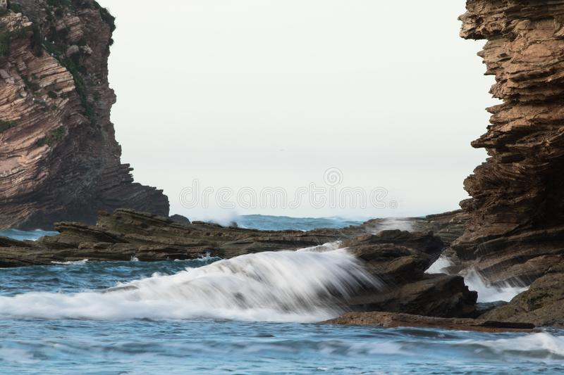 Rocky frame, cliffs of atlantic ocean with waves, abstract background stock photography