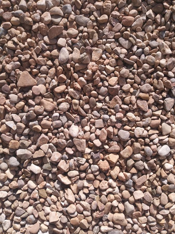 Rocky Ground. Rocks and pebbles of various sizes covering the ground stock photography