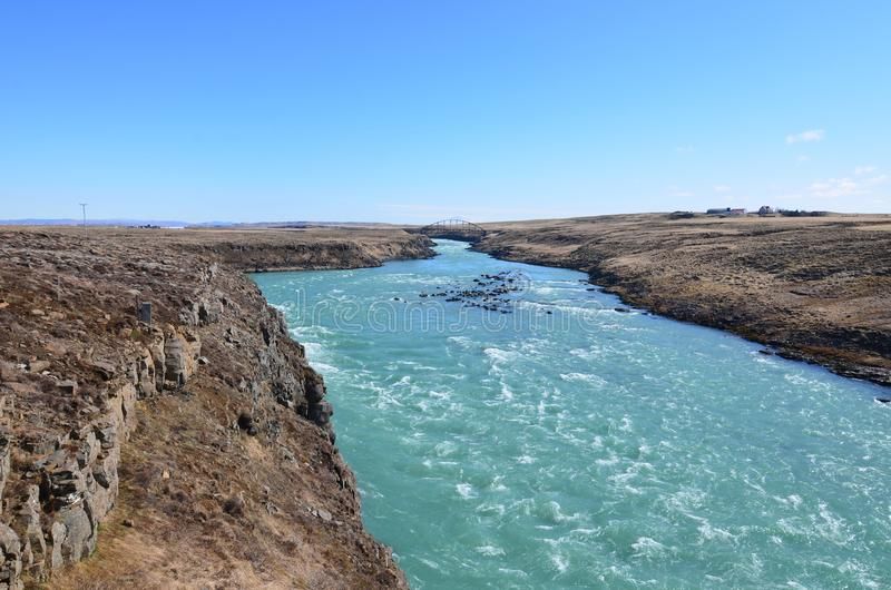 Rushing river through a rocky Icelandic landscape stock image