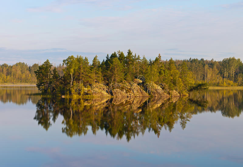 The rocky island. On the wood lake royalty free stock photo