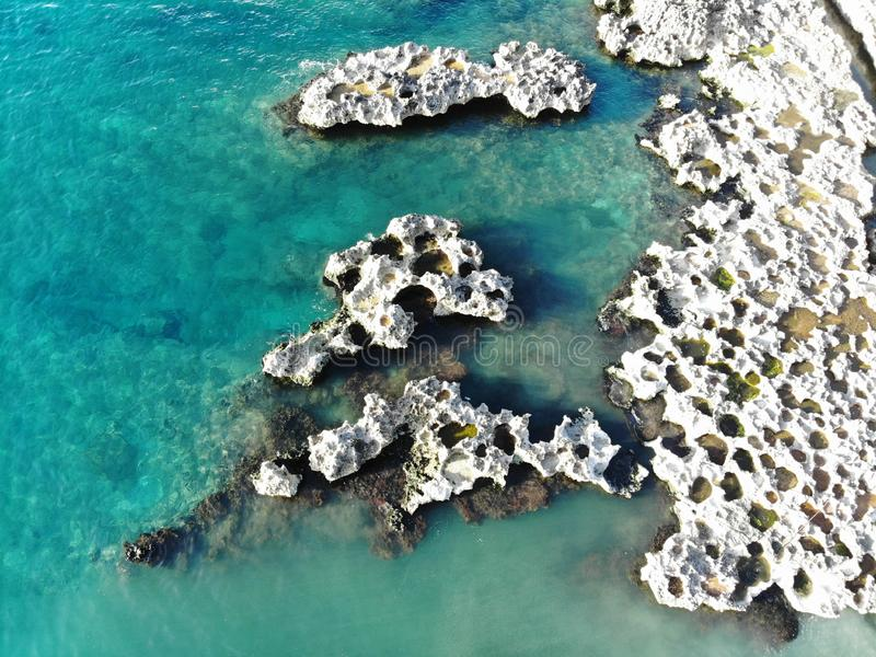 Rocky island in the caribbean. Rocky island formed of stone in the ocean sea of the caribbean royalty free stock photos