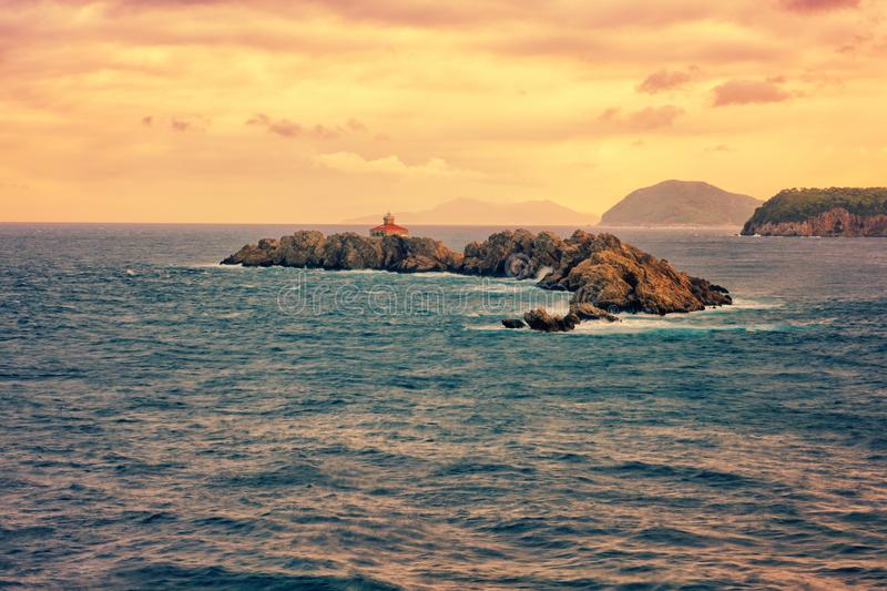 Rocky island Greben with lighthouse in the Adriatic sea, sunset seascape, Dubrovnik, Croatia. Rocky island Greben with lighthouse in the Adriatic sea, beautiful stock images
