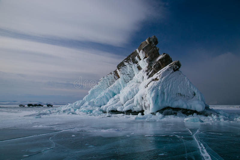 The rocky island in the ice. Of Baikal lake stock image