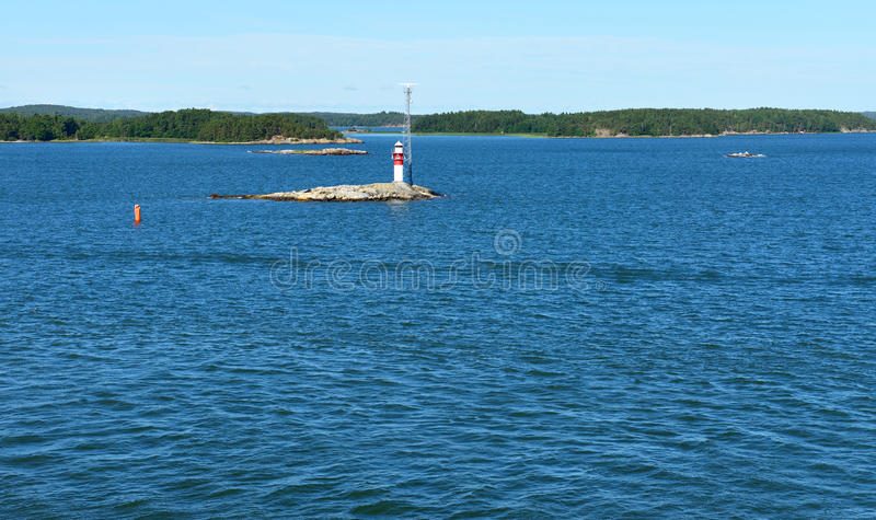 Rocky island with lighthouse. In Baltic Sea royalty free stock image