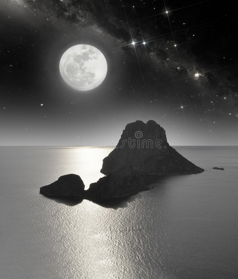 Rocky island in moonlight royalty free stock image