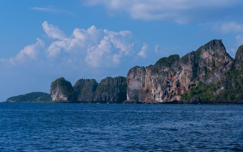Rocky island in the ocean. stock photos