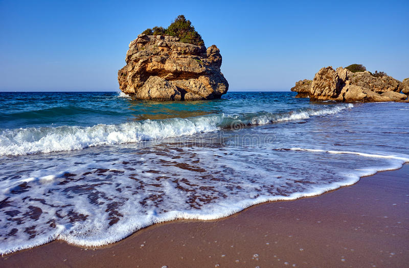 The rocky island off the beach. On the island of Zakynthos in Greece royalty free stock photos
