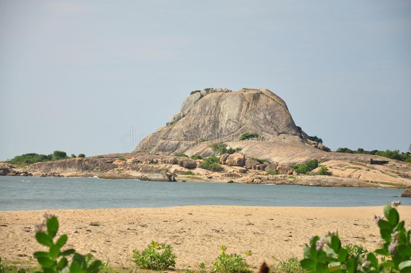 Rocky island. Near shore in southern Sri stock images