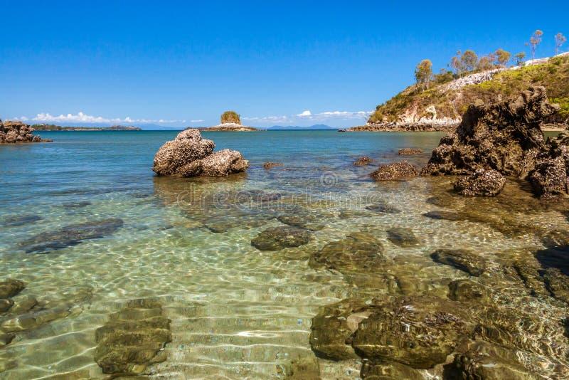 Rocky island. Stunning landscape with rocky island and clean water, Nosy Sakatia near Nosy Be, Madagascar, bay, beach, beautiful, blue, cliff, coast, coastline stock photo