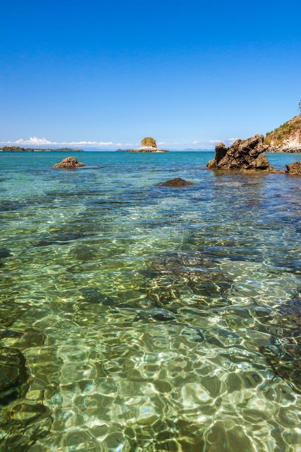 Rocky island. Stunning landscape with rocky island and clean water, Nosy Sakatia near Nosy Be, Madagascar, bay, beach, beautiful, blue, cliff, coast, coastline stock photography