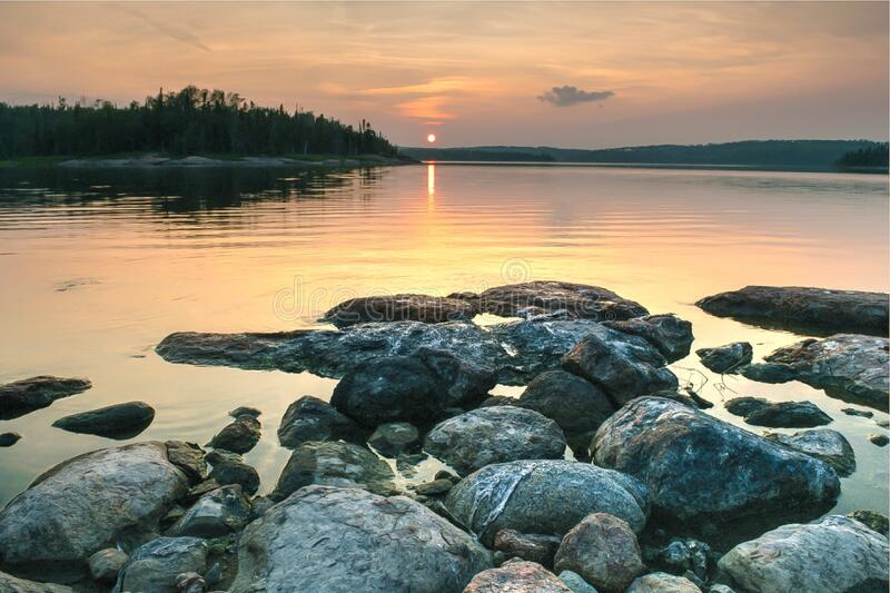 Rocky Lake Shore during Sunset stock images