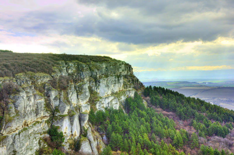 Rocky landscape with cloudy sky stock photography