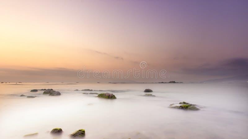 Rocky landscape shrouded in fog stock photos