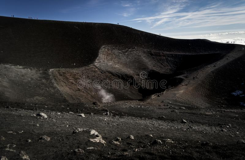 Rocky lava way around the crater of volcano Etna stock photo