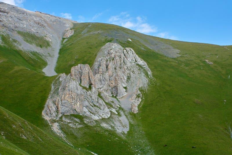 Rocky ledge on a green hillside Arkhyz Karachay-Cherkessia, North Caucasus Russia. Rocky ledge on a green hillside Arkhyz North Caucasus Russia stock images